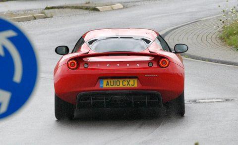 Mode of transport, Automotive design, Road, Vehicle, Land vehicle, Road surface, Performance car, Car, Vehicle registration plate, Automotive lighting,