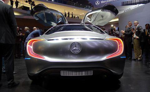 Motor vehicle, Automotive design, Mode of transport, Event, Vehicle, Car, Personal luxury car, Automotive lighting, Performance car, Auto show,