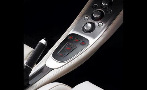 Beige, Luxury vehicle, Gear shift, Machine, Silver, Carbon,