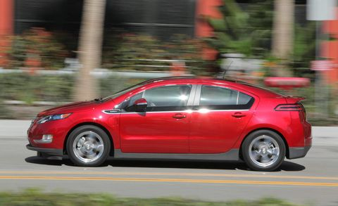 Tire, Wheel, Vehicle, Automotive design, Car, Automotive tire, Red, Automotive wheel system, Alloy wheel, Rim,