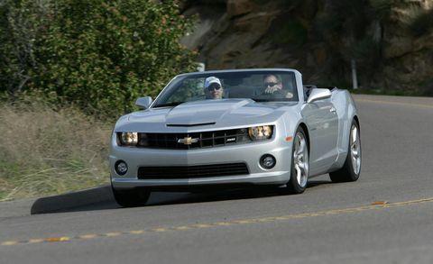Road, Automotive design, Vehicle, Hood, Headlamp, Infrastructure, Automotive lighting, Road surface, Asphalt, Car,
