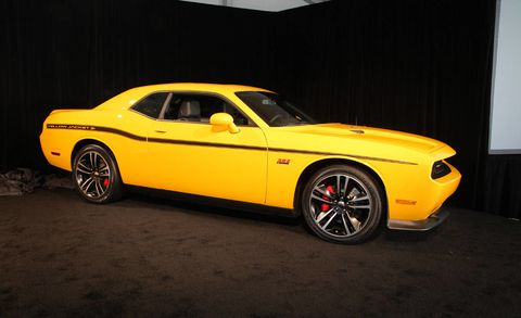 Tire, Motor vehicle, Wheel, Automotive design, Automotive tire, Yellow, Vehicle, Rim, Hood, Automotive wheel system,