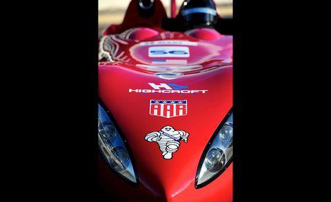 Automotive design, Headlamp, Automotive lighting, Motorcycle, Light, Logo, Carmine, Windshield, Motorcycle accessories, Racing,