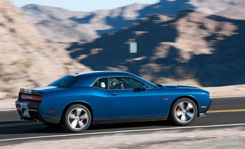 Tire, Wheel, Automotive design, Automotive tire, Blue, Vehicle, Infrastructure, Rim, Performance car, Automotive wheel system,