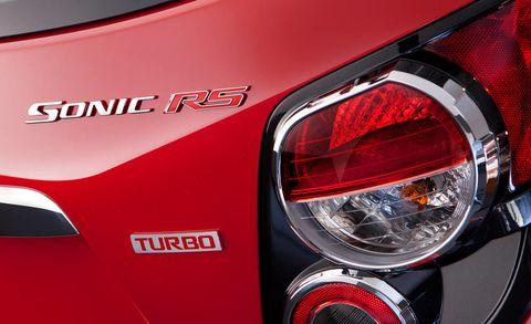 Automotive tail & brake light, Automotive design, Automotive lighting, Red, Automotive exterior, Logo, Light, Carmine, Automotive light bulb, Personal luxury car,