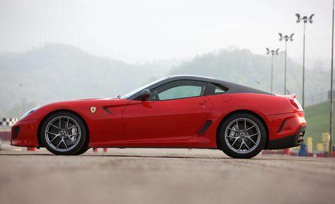 Tire, Wheel, Mode of transport, Automotive design, Vehicle, Rim, Performance car, Car, Red, Alloy wheel,