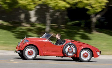 Wheel, Tire, Automotive design, Vehicle, Car, Fender, Classic car, Automotive lighting, Automotive tire, Sports car,