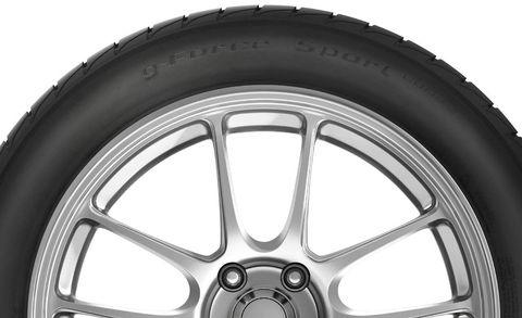 Wheel, Automotive tire, Spoke, Automotive wheel system, Alloy wheel, Rim, White, Synthetic rubber, Automotive exterior, Tread,