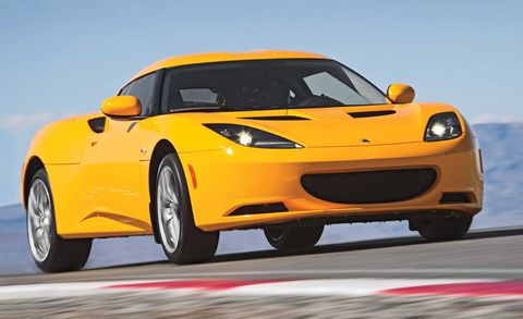 Tire, Automotive design, Yellow, Vehicle, Automotive parking light, Hood, Performance car, Car, Rim, Fender,