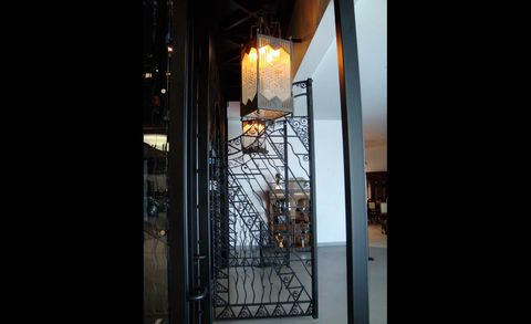 Glass, Iron, Fixture, Light fixture, Metal, Lantern, Building material, Transparent material, Electrical supply,