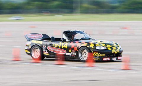 Tire, Automotive design, Automotive tire, Vehicle, Motorsport, Sports car racing, Car, Automotive wheel system, Auto racing, Race car,
