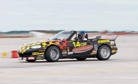 Tire, Wheel, Automotive design, Automotive tire, Vehicle, Motorsport, Hood, Car, Sports car racing, Performance car,