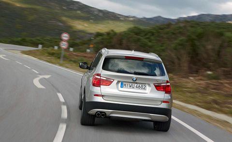 Motor vehicle, Road, Automotive tail & brake light, Automotive design, Mode of transport, Vehicle registration plate, Vehicle, Mountainous landforms, Automotive mirror, Automotive exterior,