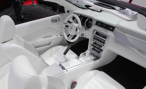 Motor vehicle, Steering part, Steering wheel, Vehicle, Automotive design, White, Center console, Car seat, Vehicle door, Personal luxury car,