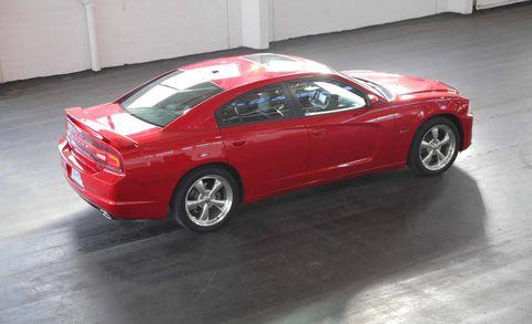 Tire, Wheel, Automotive design, Vehicle, Land vehicle, Floor, Rim, Car, Red, Automotive tire,