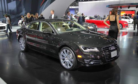 Tire, Wheel, Automotive design, Land vehicle, Vehicle, Event, Car, Grille, Personal luxury car, Auto show,