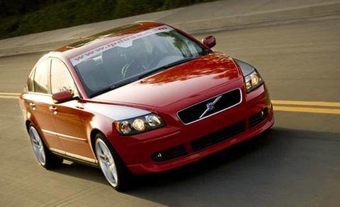 Automotive design, Vehicle, Automotive mirror, Land vehicle, Hood, Road, Car, Grille, Fender, Rim,