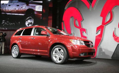 Tire, Motor vehicle, Wheel, Automotive design, Automotive tire, Vehicle, Automotive mirror, Automotive lighting, Car, Red,