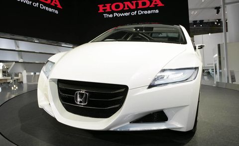Automotive design, Vehicle, Event, Grille, Glass, Car, Headlamp, Personal luxury car, Automotive lighting, Logo,