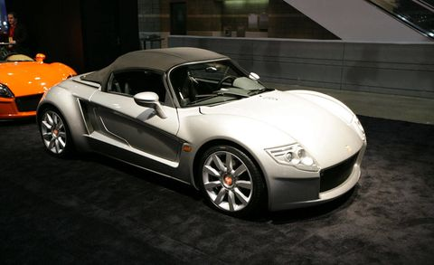 Tire, Wheel, Automotive design, Vehicle, Land vehicle, Car, Performance car, Headlamp, Alloy wheel, Automotive mirror,