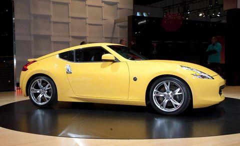 Tire, Wheel, Automotive design, Vehicle, Yellow, Car, Performance car, Automotive wheel system, Rim, Alloy wheel,