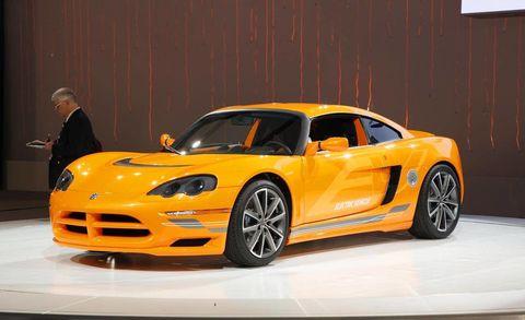 Tire, Wheel, Automotive design, Yellow, Vehicle, Rim, Hood, Performance car, Car, Alloy wheel,
