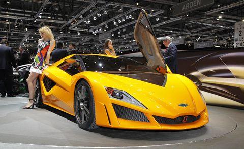 Automotive design, Vehicle, Yellow, Event, Land vehicle, Performance car, Car, Supercar, Auto show, Sports car,