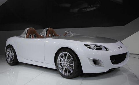 Automotive design, Mode of transport, Vehicle, Car, Automotive lighting, Fender, Alloy wheel, Automotive mirror, Personal luxury car, Automotive exterior,