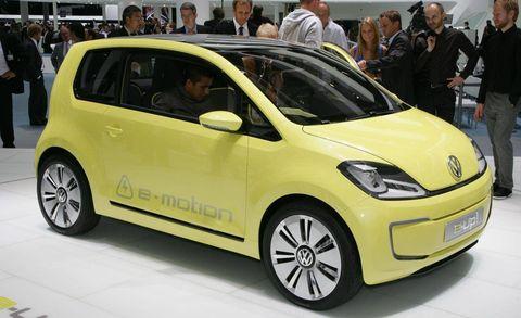 Motor vehicle, Wheel, Tire, Automotive design, Vehicle, Yellow, Car, Automotive mirror, Hatchback, Alloy wheel,