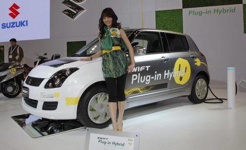 Motor vehicle, Tire, Automotive design, Vehicle, Land vehicle, Car, Auto show, Hatchback, Exhibition, Vehicle door,