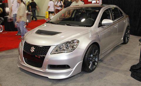 Motor vehicle, Wheel, Automotive design, Vehicle, Land vehicle, Event, Car, Grille, Fender, Automotive lighting,