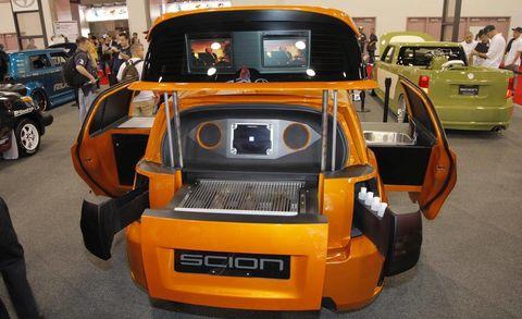 Motor vehicle, Automotive design, Land vehicle, Vehicle, Orange, Machine, Bumper, Auto show, Exhibition, Personal luxury car,