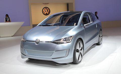 Automotive design, Vehicle, Car, Automotive mirror, Glass, Hatchback, Headlamp, Vehicle door, Alloy wheel, Bumper,