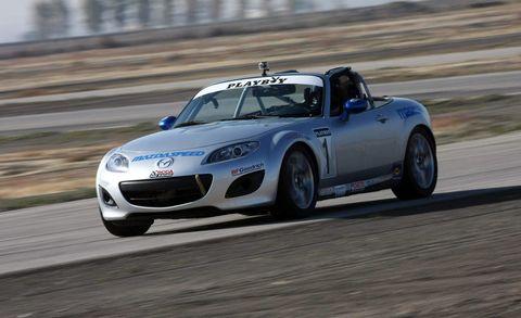 Tire, Wheel, Automotive design, Vehicle, Land vehicle, Road, Car, Hood, Performance car, Motorsport,