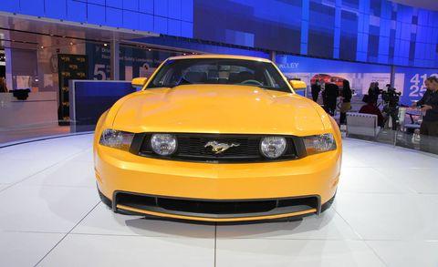 Motor vehicle, Automotive design, Yellow, Headlamp, Hood, Automotive lighting, Car, Grille, Orange, Bumper,