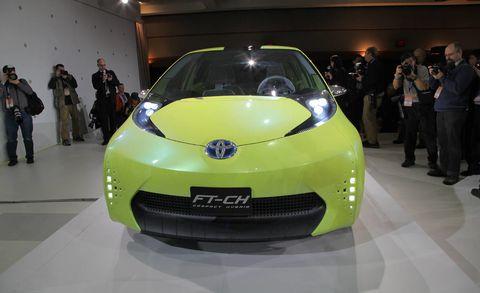 Motor vehicle, Automotive design, Event, Vehicle, Land vehicle, Car, Floor, Auto show, Exhibition, Headlamp,