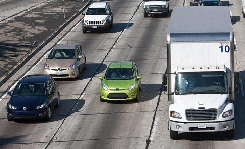 Motor vehicle, Mode of transport, Transport, Vehicle, Automotive design, Land vehicle, Car, Automotive parking light, Automotive mirror, Grille,