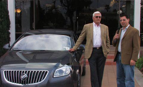Automotive design, Vehicle, Trousers, Coat, Grille, Suit trousers, Shirt, Outerwear, Automotive lighting, Suit,