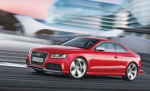 Tire, Automotive design, Automotive mirror, Vehicle, Grille, Car, Red, Rim, Alloy wheel, Automotive lighting,