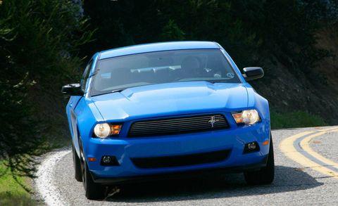 Motor vehicle, Automotive design, Blue, Daytime, Vehicle, Hood, Automotive lighting, Land vehicle, Headlamp, Grille,