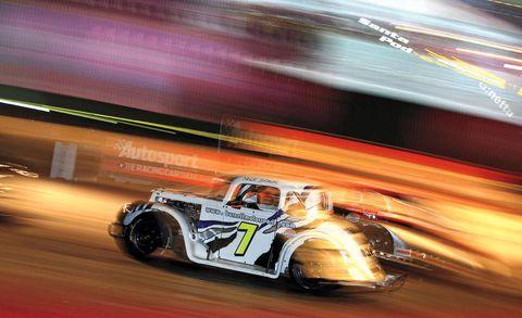Automotive design, Automotive tire, Headlamp, Motorsport, Automotive wheel system, Fender, Automotive lighting, Auto part, Logo, Race car,