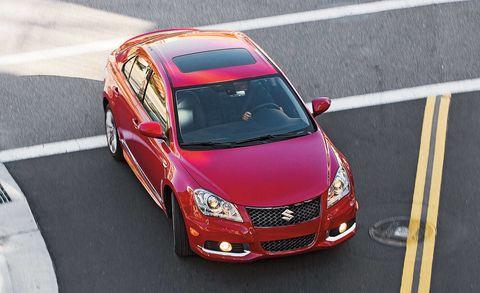 Motor vehicle, Automotive mirror, Automotive design, Vehicle, Land vehicle, Road, Automotive lighting, Hood, Asphalt, Car,