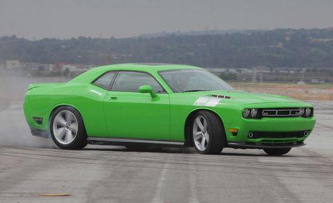 Tire, Motor vehicle, Wheel, Automotive design, Automotive tire, Blue, Green, Vehicle, Hood, Infrastructure,