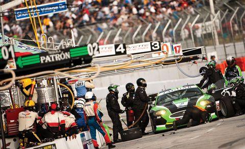 Sport venue, People, Automotive tire, Race track, Formula one, Sports car racing, Logo, Motorsport, Racing, Race car,