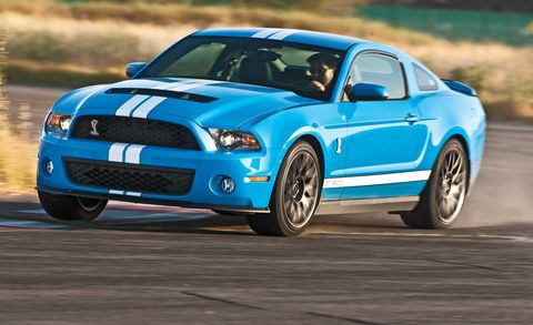 Tire, Blue, Automotive design, Daytime, Vehicle, Hood, Automotive tire, Headlamp, Car, Landscape,