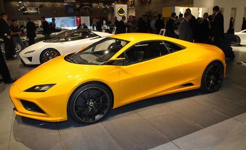 Tire, Wheel, Automotive design, Mode of transport, Vehicle, Yellow, Land vehicle, Event, Performance car, Car,