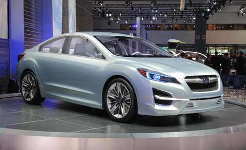 Wheel, Automotive design, Product, Vehicle, Land vehicle, Car, Mid-size car, Exhibition, Auto show, Glass,
