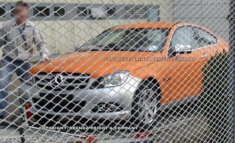 Automotive tire, Mesh, Motorsport, Wire fencing, Orange, Hood, Synthetic rubber, Auto part, Alloy wheel, Auto racing,