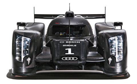 Automotive design, Automotive exterior, Logo, Machine, Bumper, Race car, Paint, Symbol, Automotive mirror, Brand,
