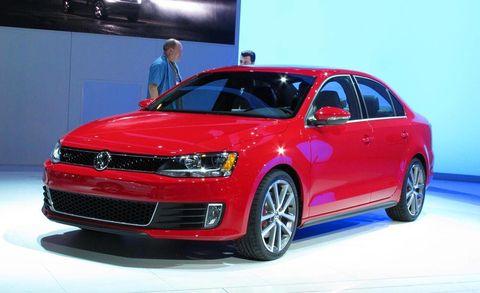 Automotive design, Vehicle, Car, Red, Alloy wheel, Fender, Rim, Automotive lighting, Technology, Vehicle door,